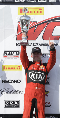 Kia Racing's Mark Wilkins pilots the No. 38 to victory at Barber Motorsports Park. (PRNewsFoto/Kia Motors ...