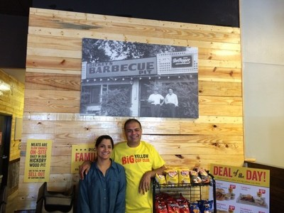 Sheila and Mo Afzal inside their new Dickey's Barbecue Pit in Richardson. The three-day grand opening kicks off on Thursday with the first 50 guests receiving gift cards. (PRNewsFoto/Dickey's Barbecue)
