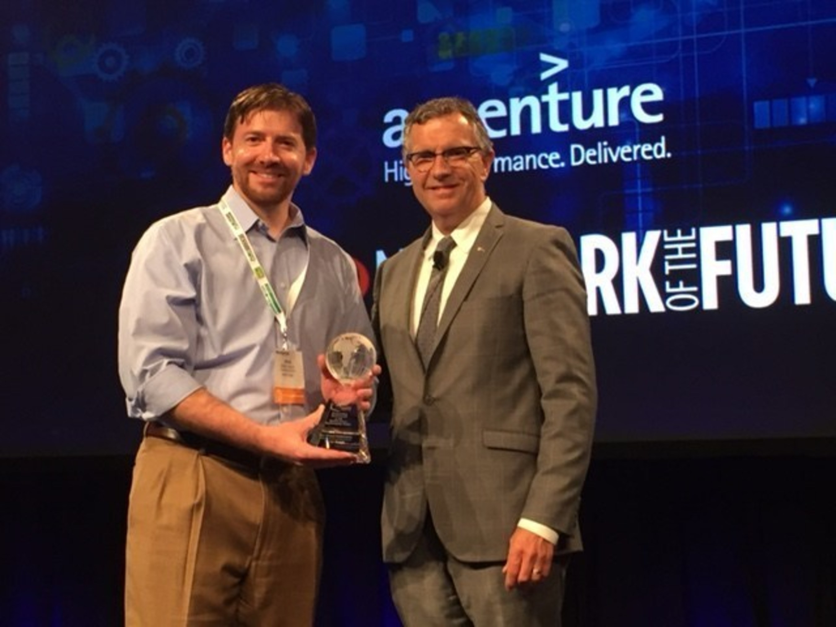 Sector Supply COO, Shiloh Coleman, being presented the 2016 Global Sustainability Award for Best Overall Performance by QuEST Forum CEO, Fraser Pajak