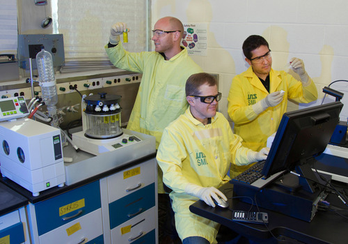 From left, Los Alamos scientists Roy Copping, Sean Reilly, and Daniel Rios. Copping examines the Buchi ...