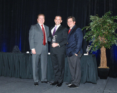 "BallenIsles Director of Golf Awarded ""Troon Golf Professional of the Year"" - Pictured left to right: Dana Garmany, Chairman and CEO, Troon Golf; Brian Kelley, Director of Golf, BallenIsles Country Club; John Easterbrook, Executive Vice President, Operations, Troon Golf.  (PRNewsFoto/BallenIsles Country Club)"