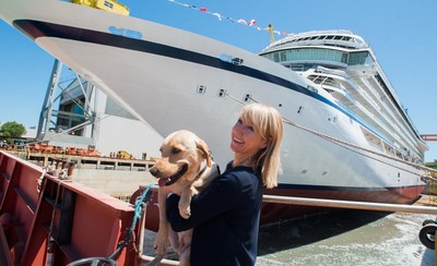 Viking Sea's godmother, Karine Hagen, and her traveling yellow Labrador, Finse, during the ship's float out ceremony on June 25. The traditional ceremony took place yesterday, June 25, at Fincantieri's Ancona shipyard.