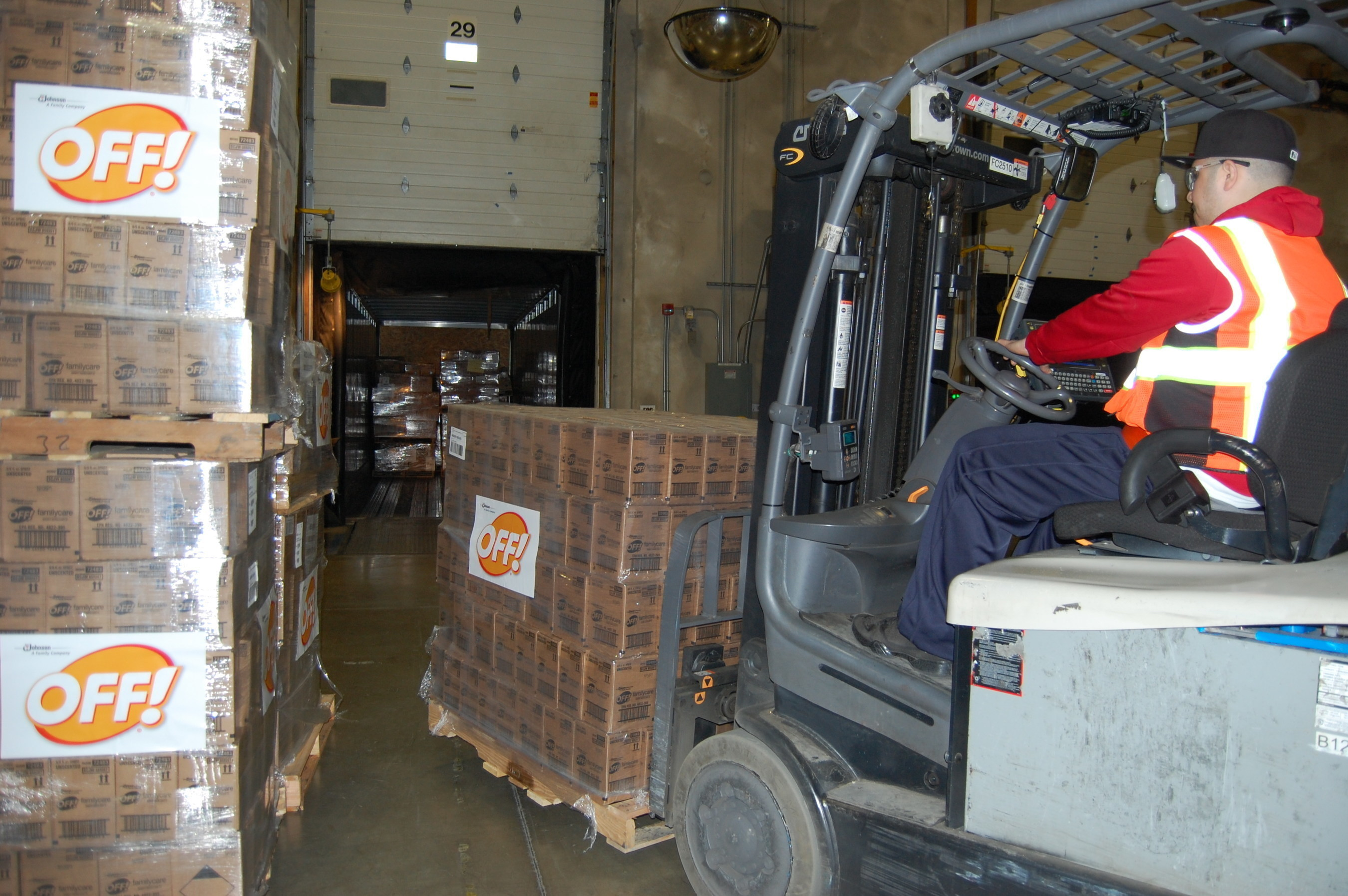 Donated OFF! products from SC Johnson being loaded for shipping to leading organizations that will distribute to the needy.