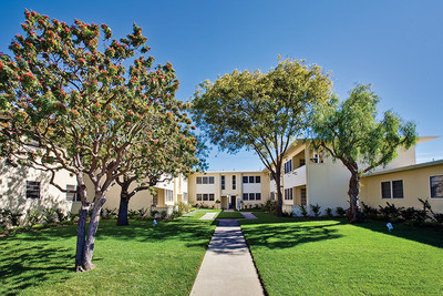 Aimco preserved the mid-century modern architecture of Lincoln Place and the community's many green spaces featuring native trees.