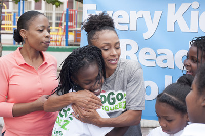 Dominique Dawes, Olympic Gold Medalist and GoGo squeeZ Goodness Ambassador, gives students at P.S. 6 in Brooklyn, NY a squeeZ after leading a workout and announcing a grant to improve access to healthy foods and fitness on behalf of GoGo squeeZ and Action for Healthy Kids on September 21, 2016. (Photo by Phillip Reed).