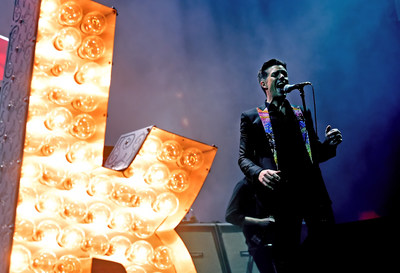 The Killers Perform at T-Mobile Arena Grand Opening. Photo Credit Kevin Winters Getty. ABA: Brandon Flowers of The Killers told the crowd when he heard T-Mobile Arena was opening, he wanted the Las Vegas-born band to be part of it. Photo credit: Kevin Winters / Getty