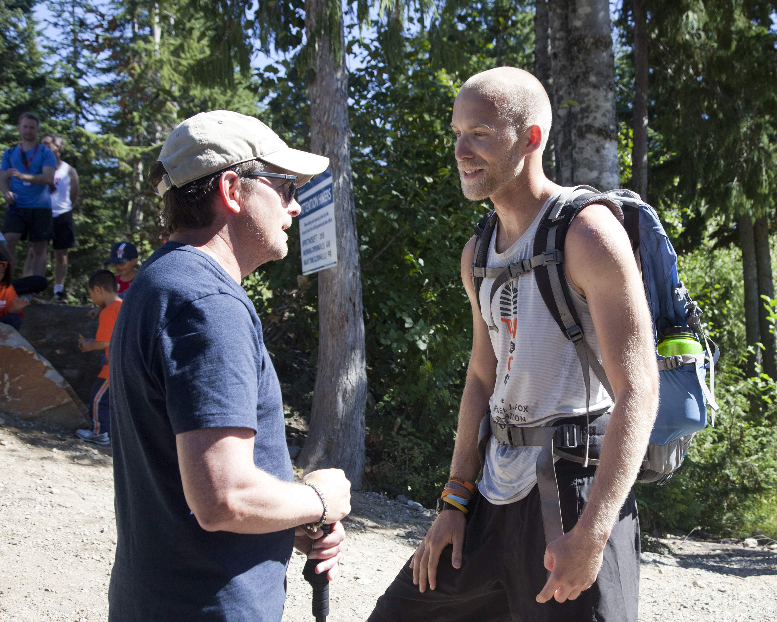 Michael J. Fox congratulates ultra-athlete Sam Fox (no relation) atop of Grouse Mountain in Vancouver, BC, on Saturday, September 12. The climb marked the end of Tour de Fox, a 103-day odyssey across the contiguous United States and into Canada that raised nearly $2 million for Parkinson's research. Sam, 28, of Rhode Island, a staffer at The Michael J. Fox Foundation, biked 8,000 miles along the route and climbed the highest peak in each U.S. state. Tour de Fox galvanized more than 2,000 members of the Parkinson's community to take part in the quest to speed a cure for Parkinson's disease. Sam completed the Tour in honor of his mother, Lucy, who was diagnosed with Parkinson's in 2000.