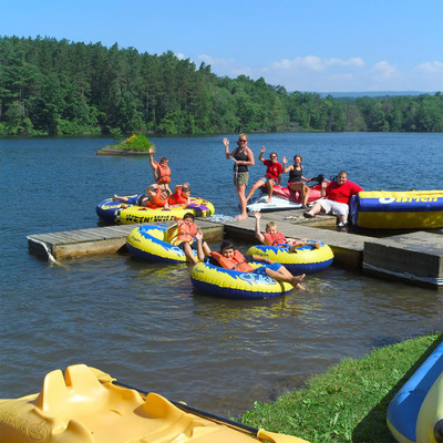 Boys and girls ages 10-17 come to Camp Pocono Trails, a weight loss camp in Reeders, Pennsylvania, each summer to get in shape.  The camp is situated on 350 private acres with a lake and separate swimming pools for boys and girls. The camp provides an environment where both losing weight and having fun are integral parts of the summer camp experience.  Kids build self-esteem and life-long friendships.  (PRNewsFoto/New Image Camps)