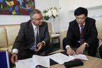 Olivier Villa, Senior VP Civil Aircraft, Dassault Aviation (left) and Mr Libing Li, director of Hospital, Beijing Red Cross Emergency Center.