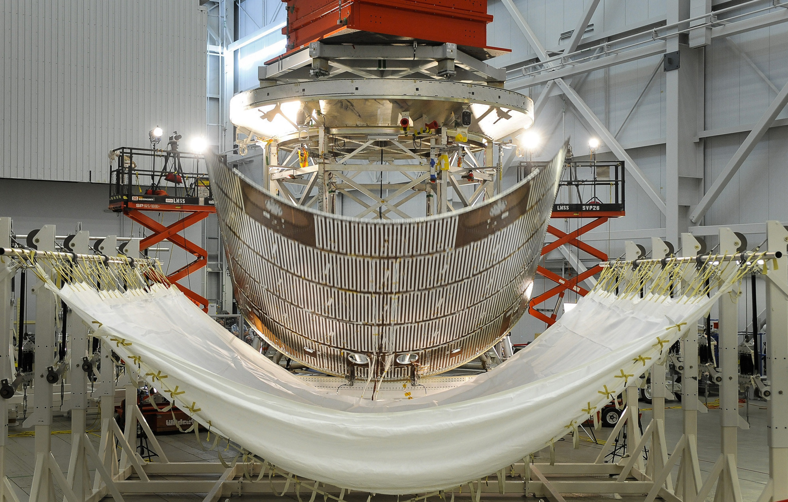A protective panel for Orion's service module is jettisoned during testing at Lockheed Martin's Sunnyvale, California facility. This test series evaluated design changes to the spacecraft's fairing separation system. Photo Credit: Lockheed Martin