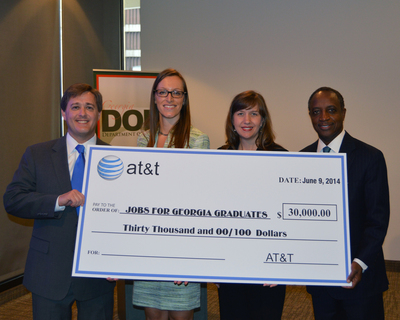 President of AT&T Georgia Beth Shiroishi, second from right, presents a check for $30,000 to State Labor Commissioner Mark Butler, left, and DeKalb County School Superintendent Michael L. Thurmond, right. Also shown is Janelle Duray, Associate Vice President of Jobs for Americas Graduates, second from left.