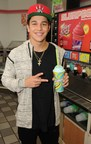 Pop star Austin Mahone enjoys a Slurpee during 7-Eleven's kickoff for Slurpee All Access Chill on May 6, 2015 in Miami, Florida.