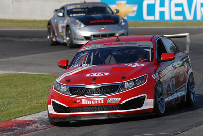 Michael Galati in the No. 36 Infinity Audio Optima captures Kia Racing's first victory in the Pirelli World Challenge at Canadian Tire Motorsports Park.  (PRNewsFoto/Kia Motors America)