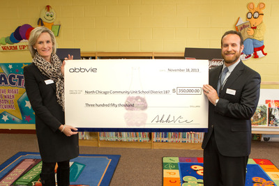Laura Schumacher, AbbVie Executive Vice President, External Affairs and Joel Pollack, Deputy Superintendent, North Chicago public schools, announce a grant to improve math education.  (PRNewsFoto/AbbVie Inc.)