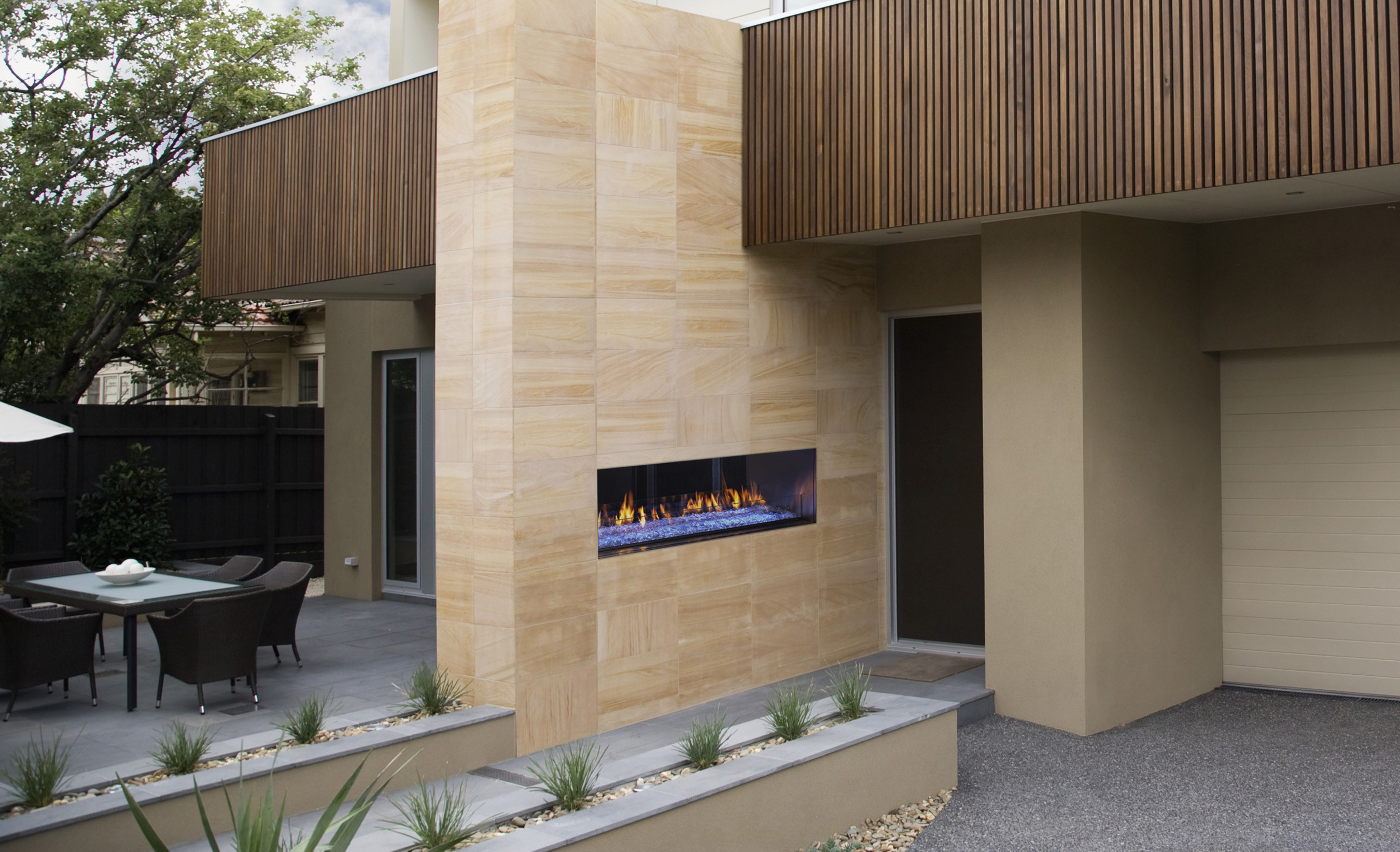 A new kind of outdoor fireplace, the Heat & Glo Palazzo features a clean, linear design that provides a contemporary focal point in an outdoor setting. The ability to install finishing material up to the firebox opening creates a unique frameless look that is built to last with marine-grade stainless steel. The industry's first remote-controlled Power Screen moves up and down for a seamless look that's both safe and easy to use, and keeps debris out of the fireplace.