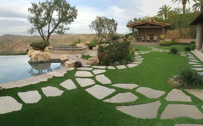 Backyard synthetic grass installation done by Grizzly Turf in Irvine, CA.