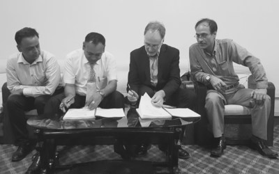 From left to right: Mr. Bijay Raj Pant, witness for Decatur; Mr. Chandra Man Shrestha, Director General DOTM; Mr. Michel Goffin, President of Decatur, and Mr. Govinda Prasad Kharel, Under Secretary DOTM. (PRNewsFoto/Decatur)