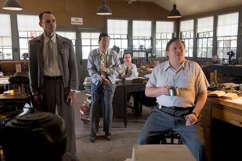 "(L-R) Christopher Denham as Jim Meeks, Eddie Shin as Sid Liao, Harry Lloyd as Paul Crosley and Michael Chernus as Louis 'Fritz' Fedowitz, in WGN America's ""Manhattan,"" premiering SUNDAY, JULY 27 (9 p.m. ET / 8 p.m. CT). (PRNewsFoto/WGN America)"