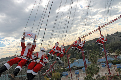 Thirty-two jolly Santas took over the SkyScreamer tower ride at Six Flags Discovery Kingdom as part of a Six Flags Flying Santas Day in conjunction with its sister parks in Arlington and San Antonio. Lively and animated Santas of all shapes and sizes prodded their invisible Comets, Prancer, Donners and Blitzens to the top of the 150' tower swing ride in celebration of the holidays and the park's annual Holiday in the Park celebration.  (PRNewsFoto/Six Flags Entertainment Corporation)