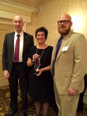NJHA's Betsy Ryan receives the HPSMNJ Special Achievement Award from Board member Anthony Stanowski (left) and President Don Dykstra.]
