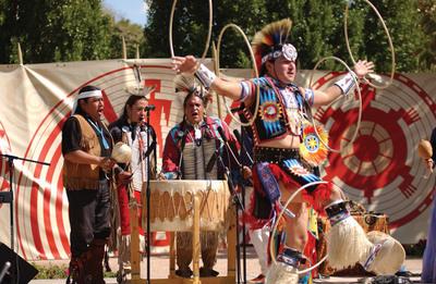 Derrick Suwaima Davis (Hopi/Choctaw), artistic director for Native Trails and five-time world-champion hoop dancer, performs a hoop dance.  (PRNewsFoto/Scottsdale Convention & Visitors Bureau)