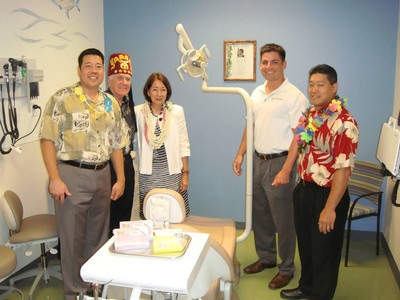 Henry Schein Dental donated a Midmark Dental Chair and Unit, as well as Nomad mobile X- ray technology to the Dr. Gary I. Kondo Dental Suite through Henry Schein Cares, the Company's global corporate social responsibility program. Pictured from L to R:  Kevin Kondo; Gene Bracewell, Treasurer for Shriners Hospital for Children; Mary Kondo; Brian Brady, Henry Schein Dental Hawaii Regional Manager; Gary Young, Director of Operations, Hawaii Family Dental Centers.  (PRNewsFoto/Henry Schein, Inc.)