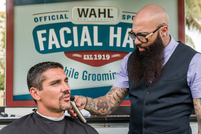 Marlins Great Carl Pavano receives a trim on his 'World Series-winning goatee' by Hugo 'Juice' Tandron the Marlins team barber at the Wahl Mobile Barbershop to celebrate Miami as the #1 Most Facial Hair Friendly City.