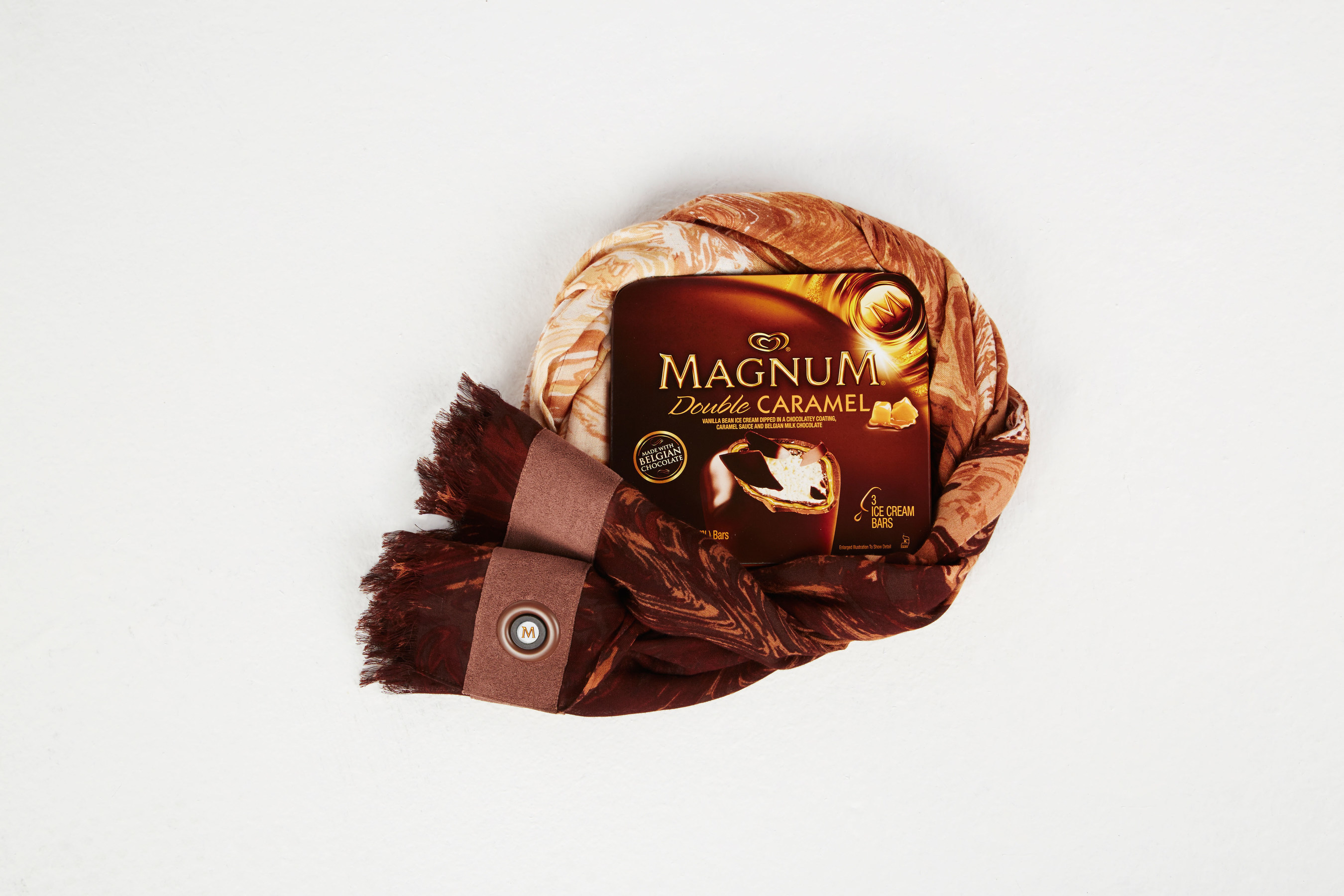 The BCBGMAXAZRIA for MAGNUM Belgian Chocolate Wrap, an innovative accessory infused with an aroma inspired by MAGNUM Belgian Chocolate. The wrap will be available as a limited edition 'gift with purchase' in select BCBGMAXAZRIA stores nationwide this summer.