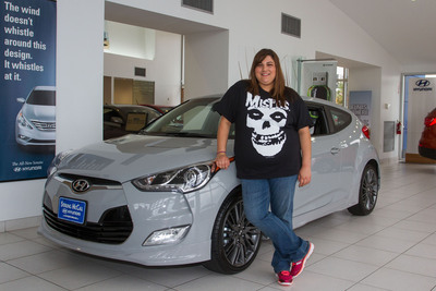 Brittany Carmona, the proud owner of the first Hyundai Veloster RE:MIX limited edition model sold, ready to take her new car home.  (PRNewsFoto/Hyundai Motor America)