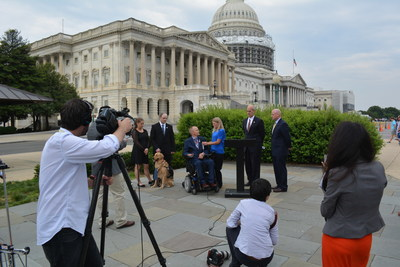 Families talk to the media outside the US Capitol in June about the need for reproductive services coverage for wounded veterans including in vitro fertilization.