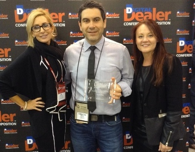 Kim DePalma, of Dealer Communications, presented the 16th Digital Dealer Website Excellence Award to Christian Salazar and Gina Reuscher, of DealerFire. (PRNewsFoto/DealerFire)