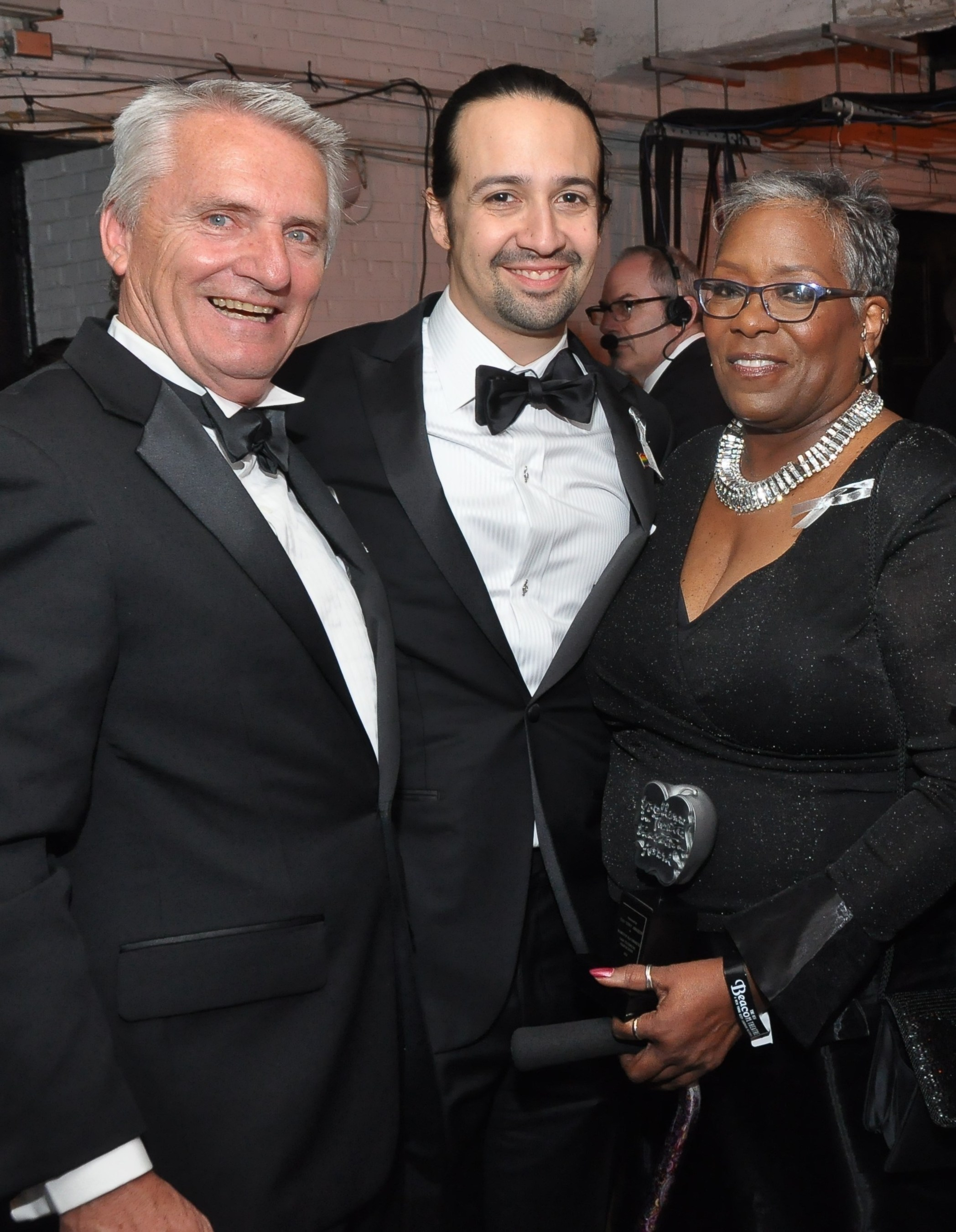 "Backstage at the 2016 Tony Awards, left to right: Carnegie Mellon University's Drama School Head, Dr. Peter Cooke; ""Hamilton"" creator and multiple Tony Awards winner, Lin-Manuel Miranda; and 2016 Excellence in Theatre Education Award winner, Marilyn McCormick. (Photo credit: Tony Awards)"