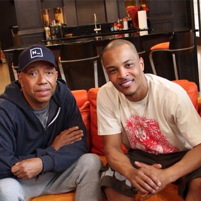 Russell Simmons and T.I. (PRNewsFoto/greenROKS)