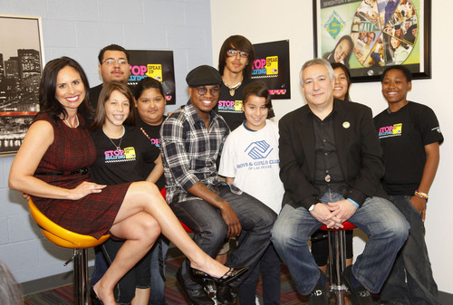 In recognition of Bullying Prevention Awareness Day, R&B star Ne-Yo (center), James Boys & Girls Club of North ...