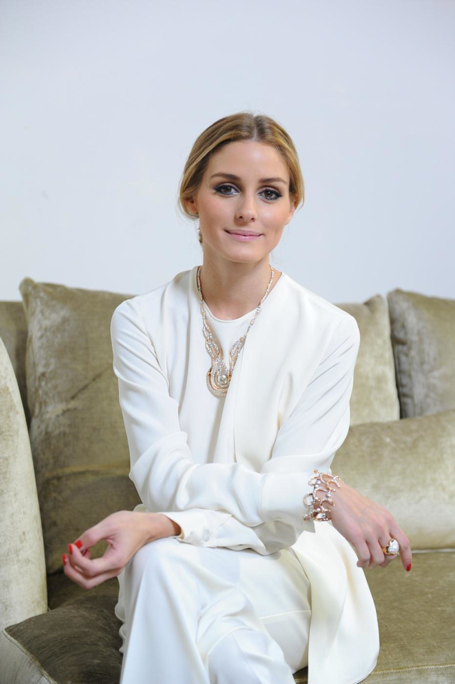 "Fashion icon Olivia Palermo joins Hearts On Fire and Chow Tai Fook as a special guest at the opening of Hearts On Fire's first store in Shanghai, China. In this photo, Palermo debuts the new Hearts On Fire ""Fire"" Collection that will exclusively launch in China."