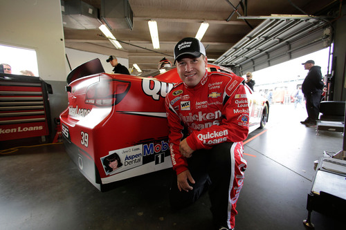 Jane Caputo, a patient at the Hyannis, Mass. Aspen Dental practice, will have her winning smile showcased on the tail of Ryan Newman's No. 39 Quicken Loans Chevrolet during the Daytona 500 at Daytona (Fla.) International Speedway on Sunday, Feb. 24.  (PRNewsFoto/Aspen Dental)
