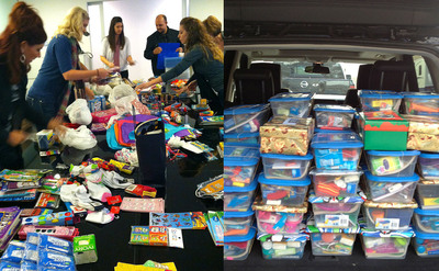 "This year the Ignite team wanted to lead by example. They spread their Christmas cheer by donating to Operation Christmas Child.  The team gathered together to sort out the different items purchased to create 48 unique boxes for children all over the world. ""Ignite always works great together as a team, but it was nice to come together for something a little different this time - knowing we would be lifting the spirits of children in need,"" said Ignite Owner Kim Wheeler.  (PRNewsFoto/Ignite Design & Advertising)"