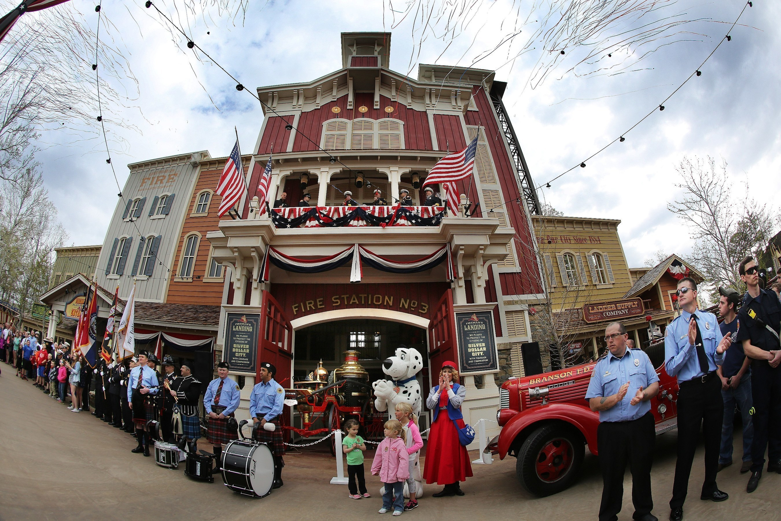 Hundreds of firefighters from around the country gather for the grand opening of Fireman's Landing, a new $8 million area at Silver Dollar City in Branson, Missouri.