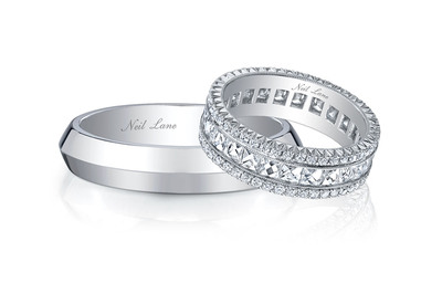 Bachelorette couple Ashley Hebert and J.P. Rosenbaum selected Neil Lane wedding bands for their big day, as seen during last night's televised special. Ashley's ring featured a handmade, platinum band with French-cut diamonds in the middle section bordered by round diamonds on the side, while J.P.'s stylish wide platinum band included a raised elliptical edge in the middle.  (PRNewsFoto/Warner Horizon)