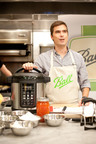 Bravo's Top Chef judge and James Beard award-winning chef Hugh Acheson demonstrates the new Ball FreshTECH Automatic Home Canning System, a revolutionary home canning appliance, at Haven's Kitchen in New York City. This first-of-its-kind appliance takes the guesswork out of the home canning process and enables consumers to auto-preserve freshly made foods with the push of a button.  (PRNewsFoto/Jarden Home Brands)
