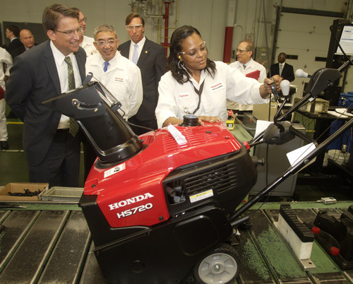 (From left:)  North Carolina Governor Pat McCrory, Honda North America President & CEO Takuji Yamada, and North Carolina State Senator Richard Gunn watch Honda Power Equipment associate Angenette Brown inspect a new Honda HS720 snow thrower.  Honda Power Equipment in Swepsonville, NC, celebrated its 30th anniversary of operations today by announcing a new $8.5 million investment in plant operations to innovate production processes and add new products. (PRNewsFoto/Honda Power Equipment Mfg., Inc.)