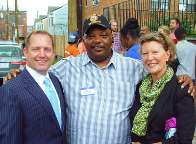 Left to right: PenFed Credit Union President and CEO James Schenck, New Homeowner Maurice Harrison and PenFed Executive Vice President and Chief Operating Officer Kevyn Myers following the DC Habitat Ivy City dedication of 11 new homes.