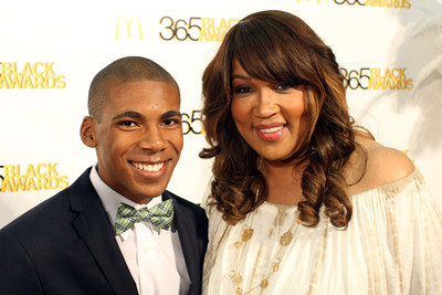 Youth environmentalist -- and McDonald's 365Black Awards honoree -- Charles Orgbon, III poses on the golden carpet with actress/comedienne Kym Whitley before the McDonald's(R)  365Black(R)  Awards. The 10th annual ceremony, held at the New Orleans Theater, took place on July 6. The McDonald's 365Black Awards are given annually to salute outstanding individuals who are committed to making positive contributions that strengthen the African-American community.  (PRNewsFoto/McDonald's USA, LLC)