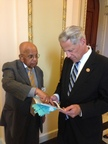 IneedMD's CEO and Co-Founder, Dr. Gopinathan talking to New York Congressman Steve Israel about the lifesaving technology behind the EKG Glove. (PRNewsFoto/IneedMD Inc.)