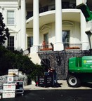 Students, faculty and alumni from the University of North Carolina School of the Arts in Winston-Salem install equipment on the South Portico of the White House in preparation for the annual trick or treat event