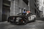 The Dodge brand recognizes that the heroic men and women who protect us must be equipped with the best performing pursuit-rated vehicle loaded with tactical equipment and technology.  And for 2015, the Dodge Charger Pursuit -- America's high-performance police vehicle -- has been significantly redesigned, infused with even more world-class safety and security, technology and pursuit-rated hardware, all while offering 370 best-in-class horsepower, factory-installed Mopar upfit packages and the segment's most advanced all-wheel-drive (AWD) system for maximum tactical performance, all-weather traction and fuel-efficiency. (PRNewsFoto/Chrysler Group LLC)