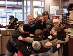 Two families Pay With Lovin' at a McDonald's restaurant outside of Pittsburgh, PA.  Following the launch of McDonald's(R) Pay with Lovin' Super Bowl commercial, the company is now randomly accepting Lovin' as a form of currency.  After the Horne and Rubenstein families placed their order, they were given the option to pay with a big group hug.