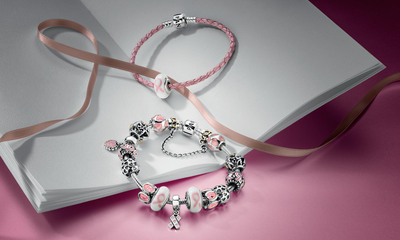 PANDORA IS PROUD TO MARK ITS CONTINUED COMMITMENT TO SUPPORTING THE FIGHT AGAINST BREAST CANCER WORLDWIDE.  (PRNewsFoto/PANDORA)