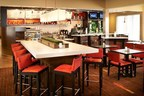 The Bistro - Eat. Drink. Connect. at the recently renovated Courtyard Toledo Airport Holland is serving up breakfast and dinner for guests in town for the Marathon Classic, Northwest Ohio Rib-Off and National Tractor Pulling Championships. Travelers who take advantage of the Stay for Breakfast Package will receive deluxe accommodations plus a complimentary breakfast for two adults and two children. For information, visit www.Marriott.com/TOLCH or call 1-419-866-1001. (PRNewsFoto/Courtyard Toledo Airport Holland)