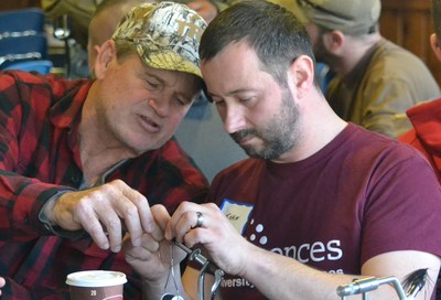 Wounded veterans learn to tie flies at WWP hosted event.
